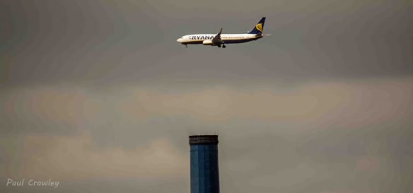 05.05.13. Ryanair plane over the Blue-topped chimney at Weston point. Paul Crawley.